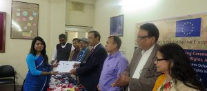 A fellow is receiving her certificate from the Deputy Commissioner of Rajshahi S. M. Abdul Kader -